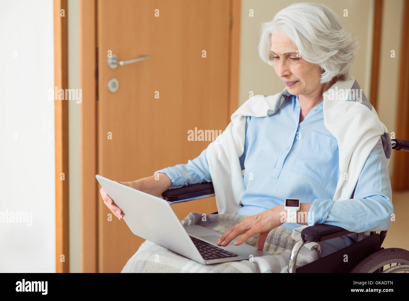 Senior female patient using computer - Stock Image