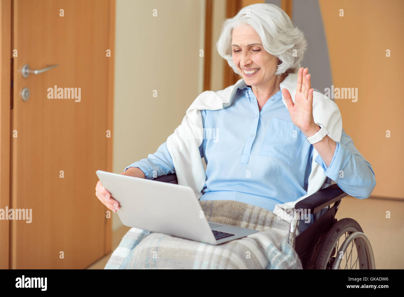 Senior female patient using laptop - Stock Image