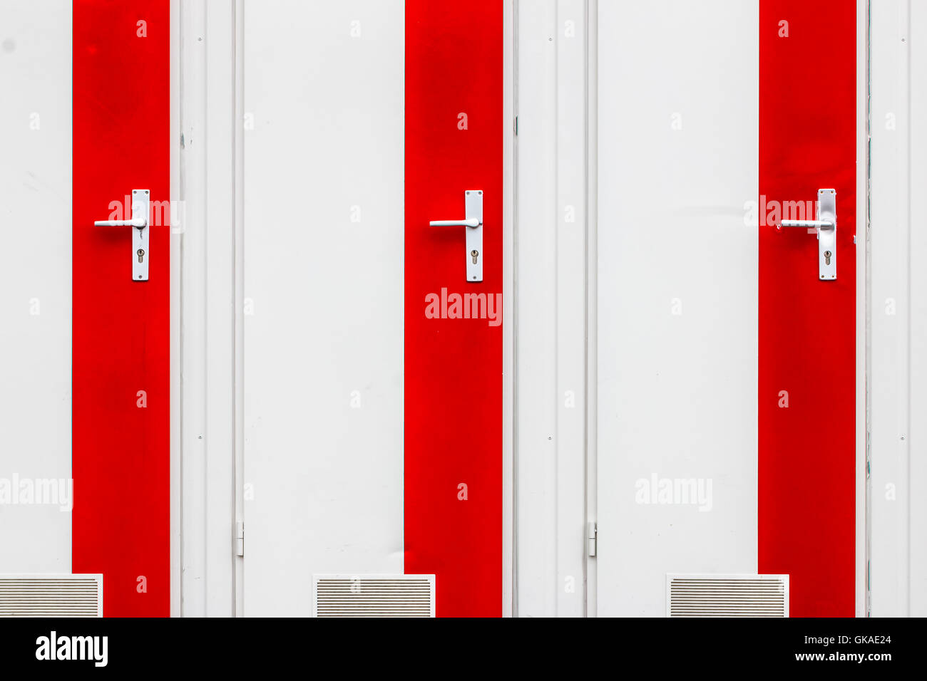 closeup of white and red doors - Stock Image