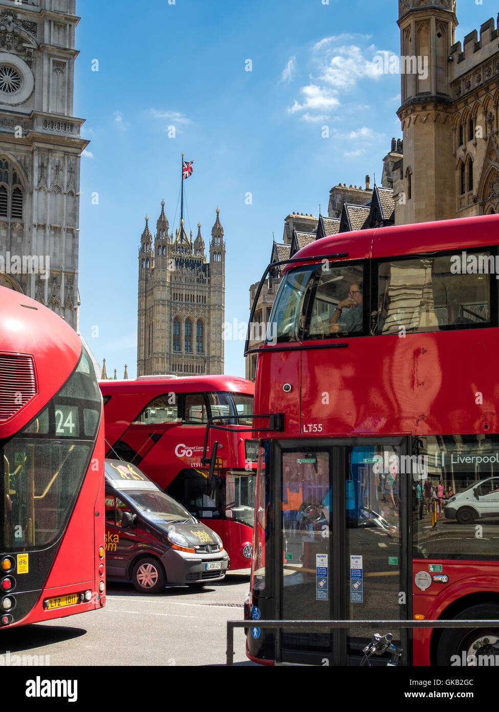 London Buses next to Westminster Abbey - Stock Image