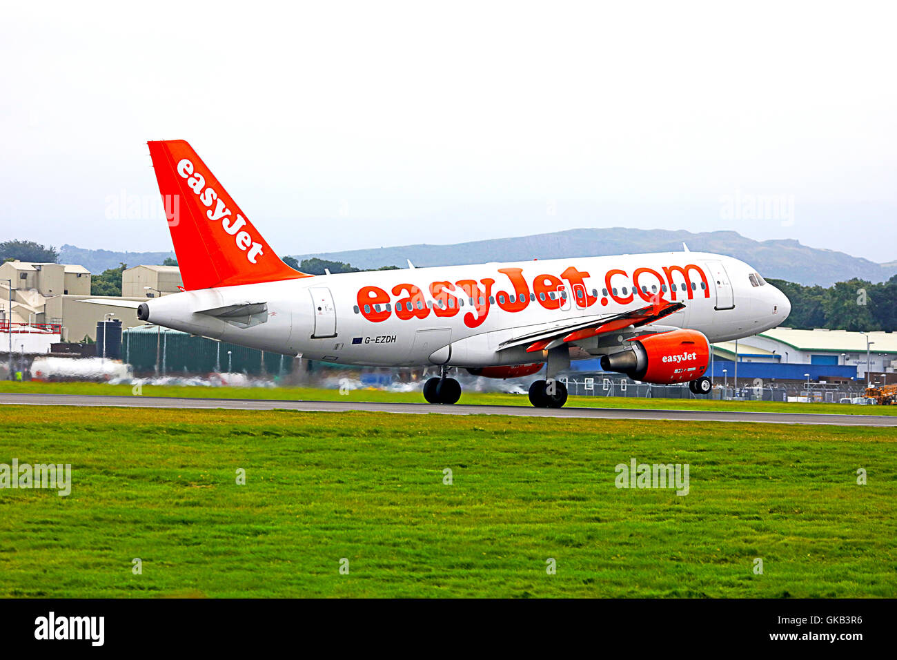 Easyjet (Airbus A319-111} taking off from Edinburgh Airport.Scotland, - Stock Image