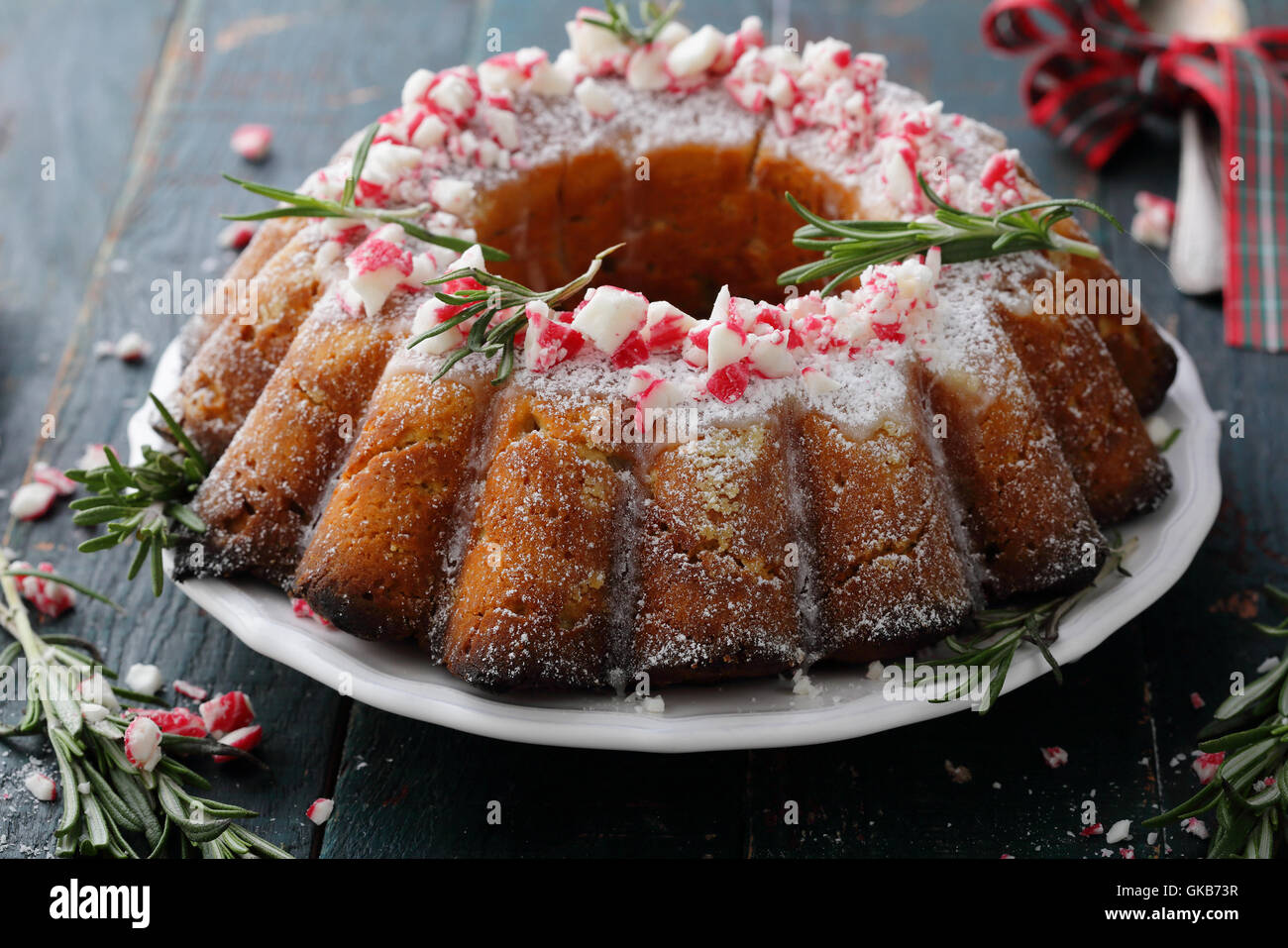 Round christmas cake with icing, food close-up - Stock Image