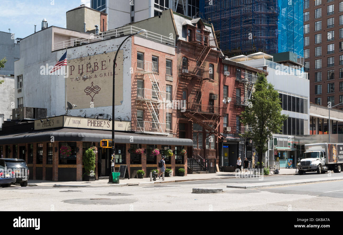 Street view of Phebe's Tavern and Grill, and landmarked Germania Fire Insurance Company Bowery Building (centre) - Stock Image