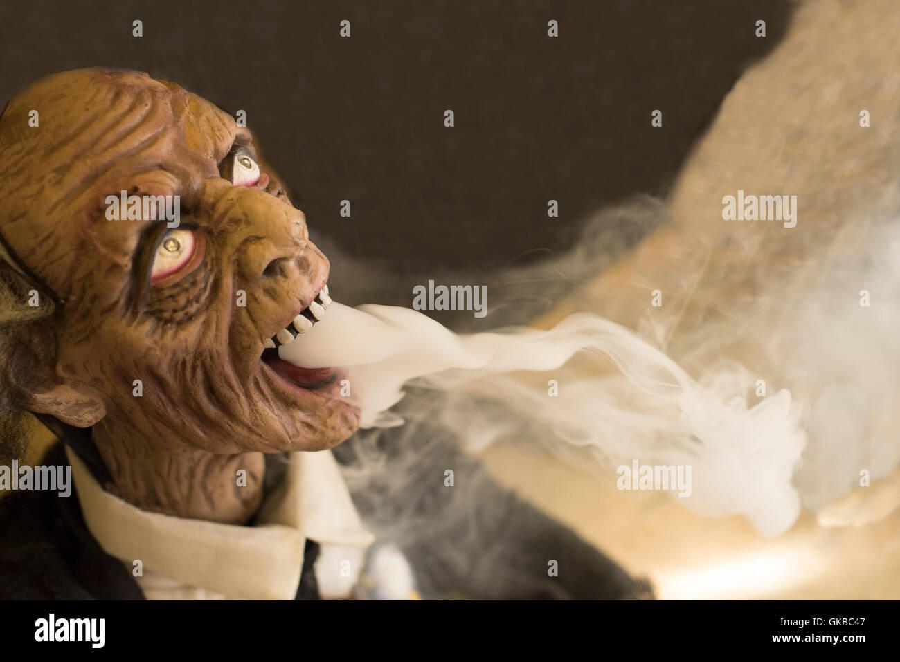 Creepy dead man mas breathing fog - Stock Image