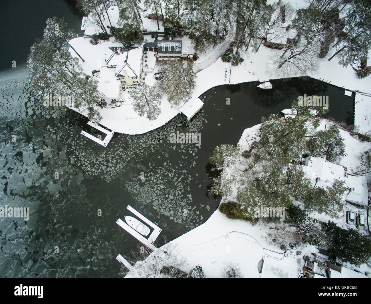 Aerial of Crystal Lake in winter with snow and ice, Virginia Beach, Virginia - Stock Image