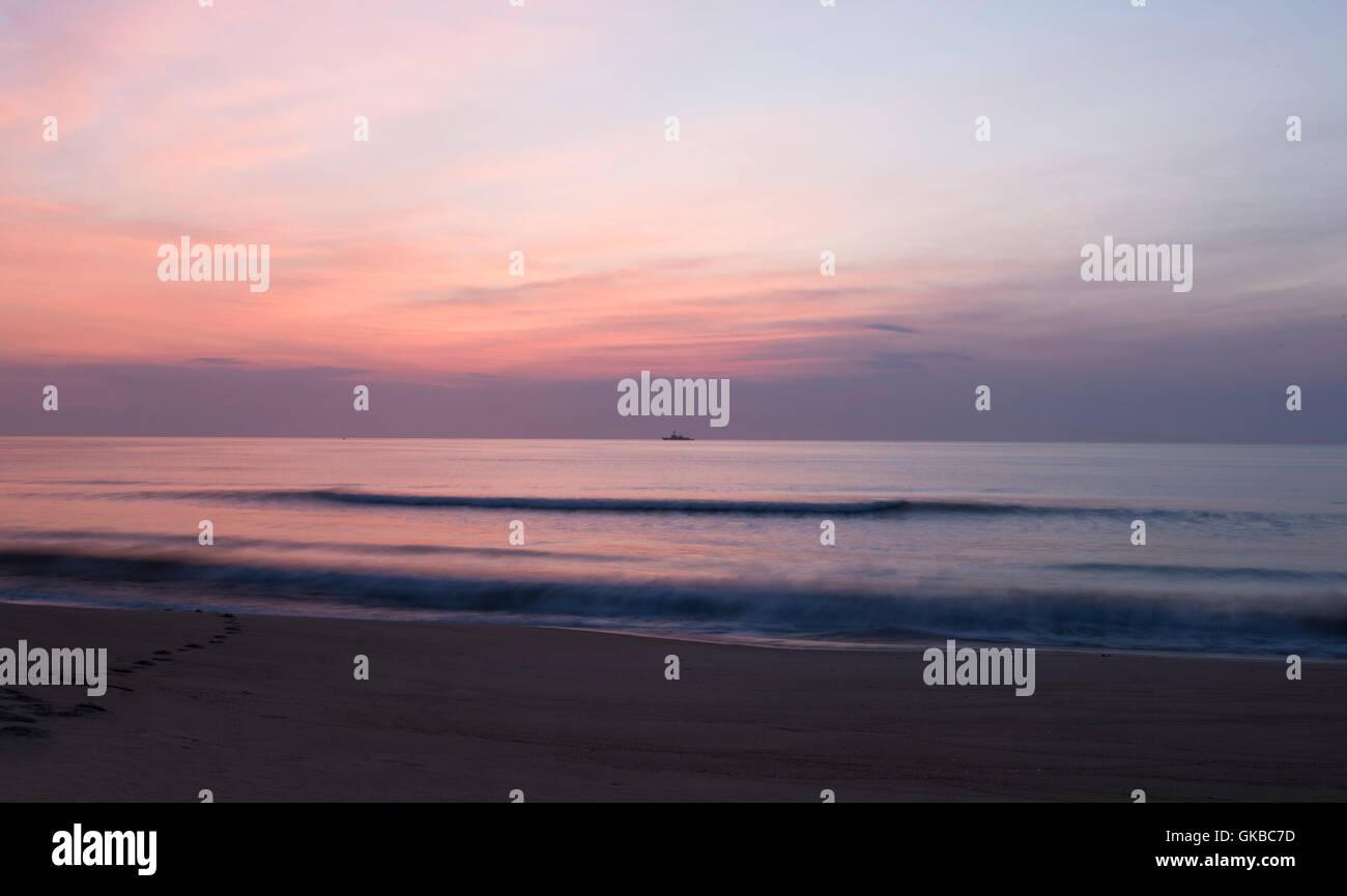 Virginia Beach oceanfront at sunrise - Stock Image