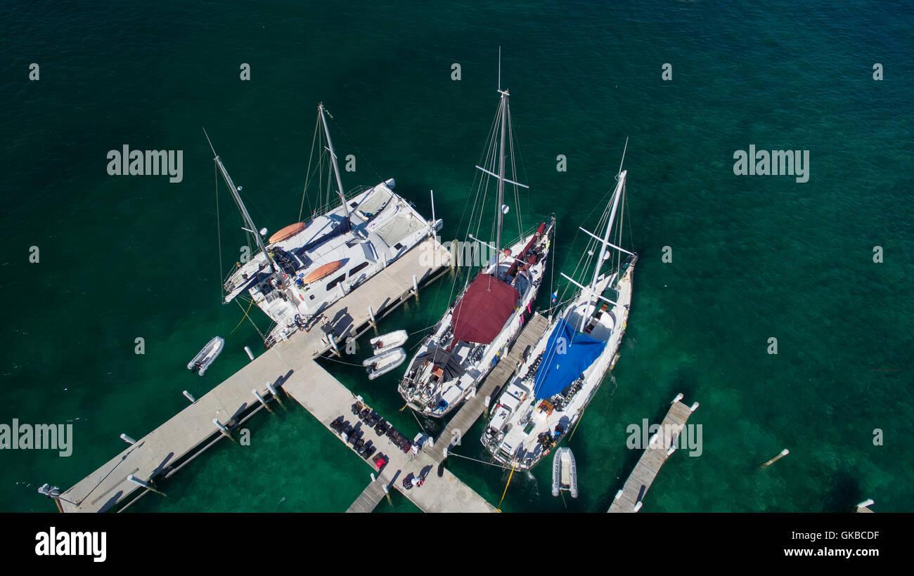 Aerial of sailboats at a dock, Exuma Cays, Bahamas Islands - Stock Image