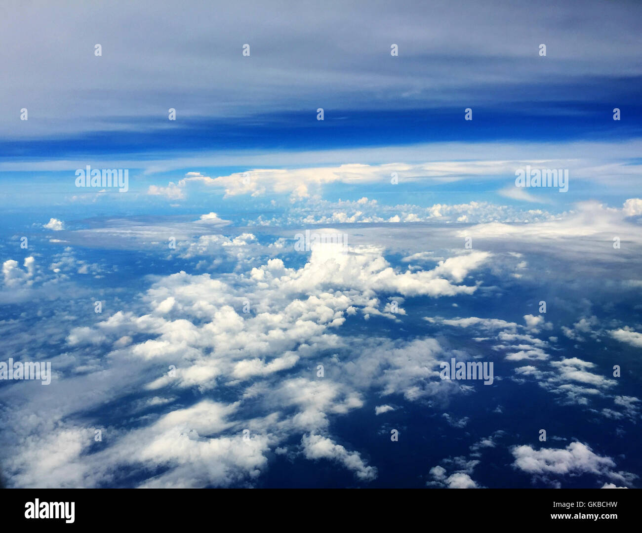 Aerial of clouds in a blue sky - Stock Image