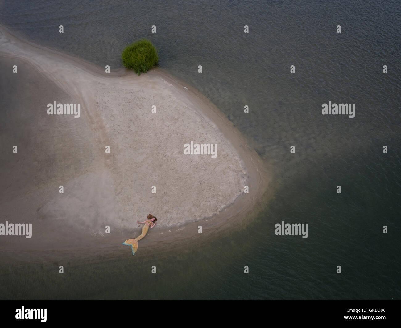 Mermaid laying on a sandbar in Virginia Beach, VA - Stock Image