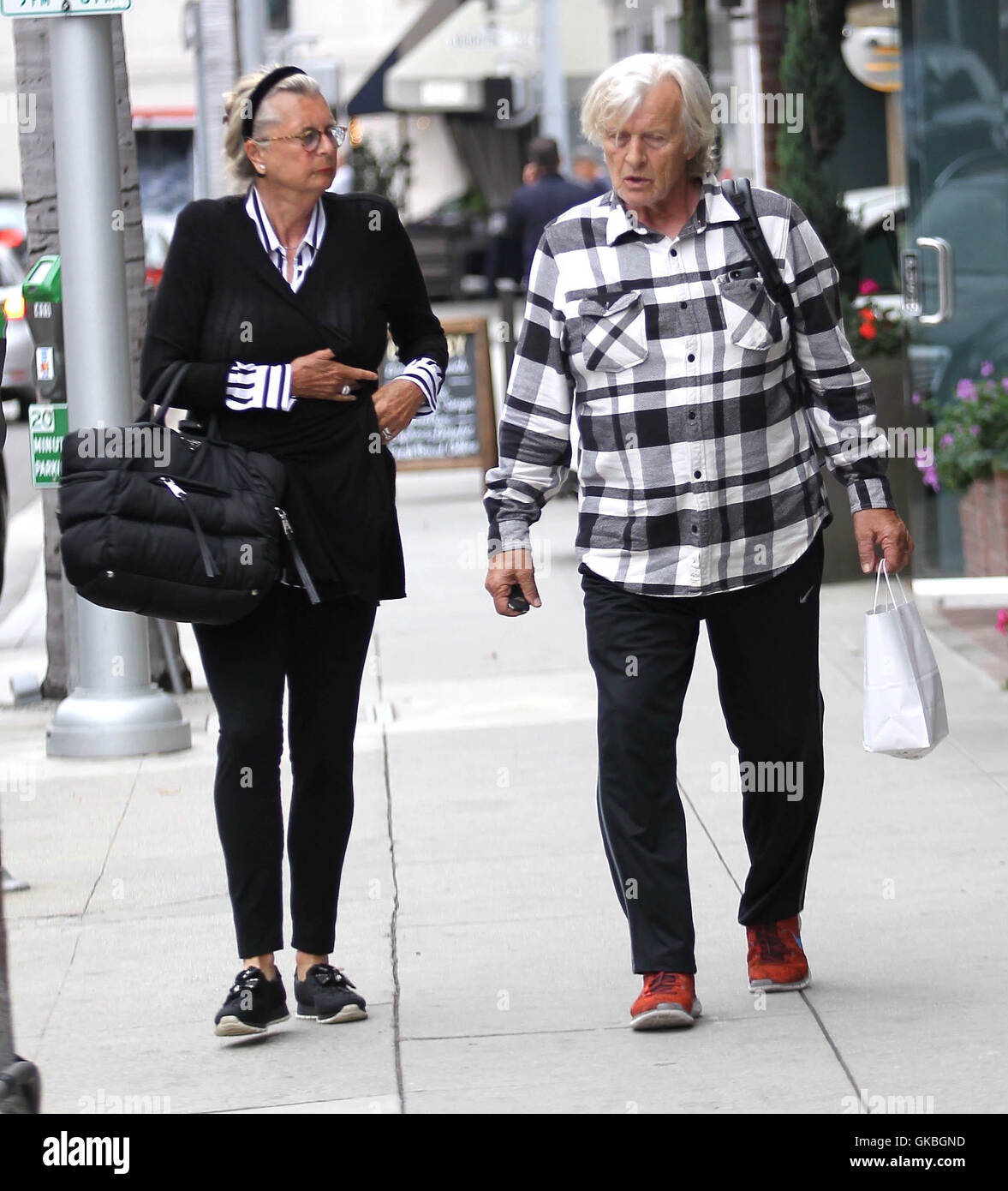 https://c8.alamy.com/comp/GKBGND/rutger-hauer-and-his-wife-go-shopping-in-beverly-hills-featuring-rutger-GKBGND.jpg