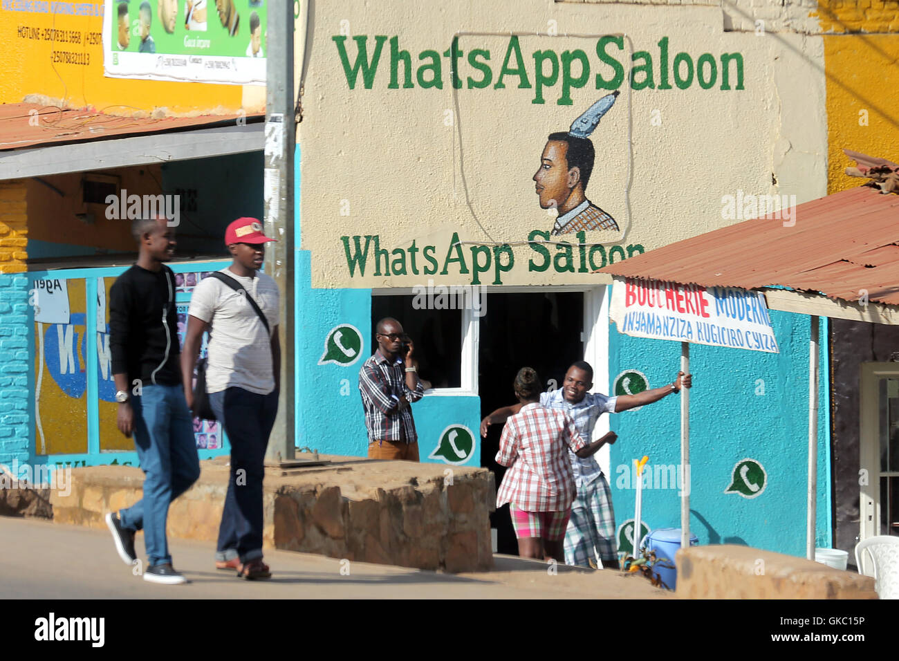Men´s hairdressers saloon named after the WhatsApp messenger in Kigali, Rwanda, Africa. - Stock Image