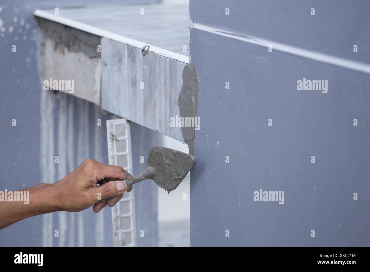 construction worker tiler is tiling, ceramic tile floor adhesive ...