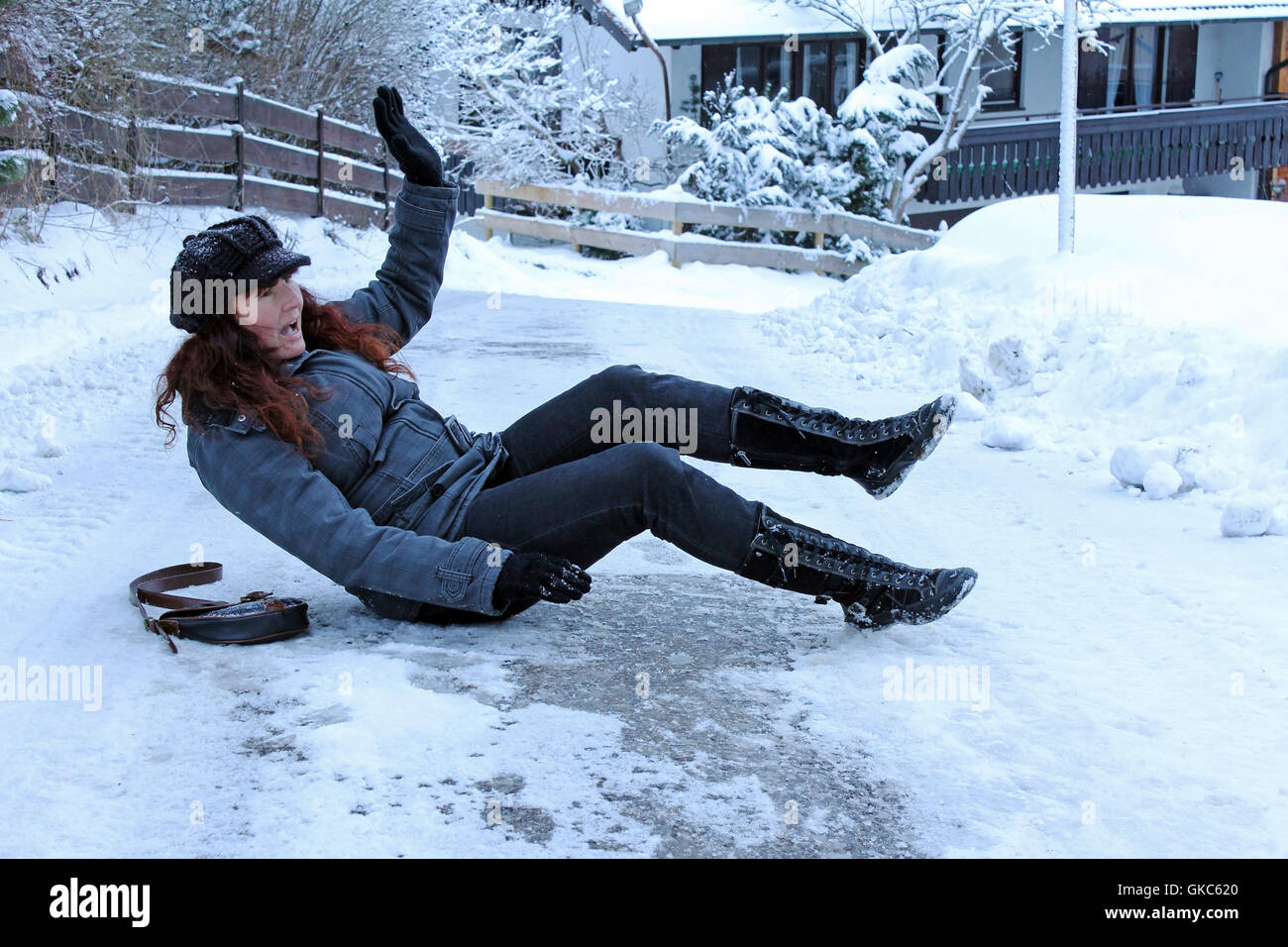 slipping in packed snow and ice on the roads - Stock Image