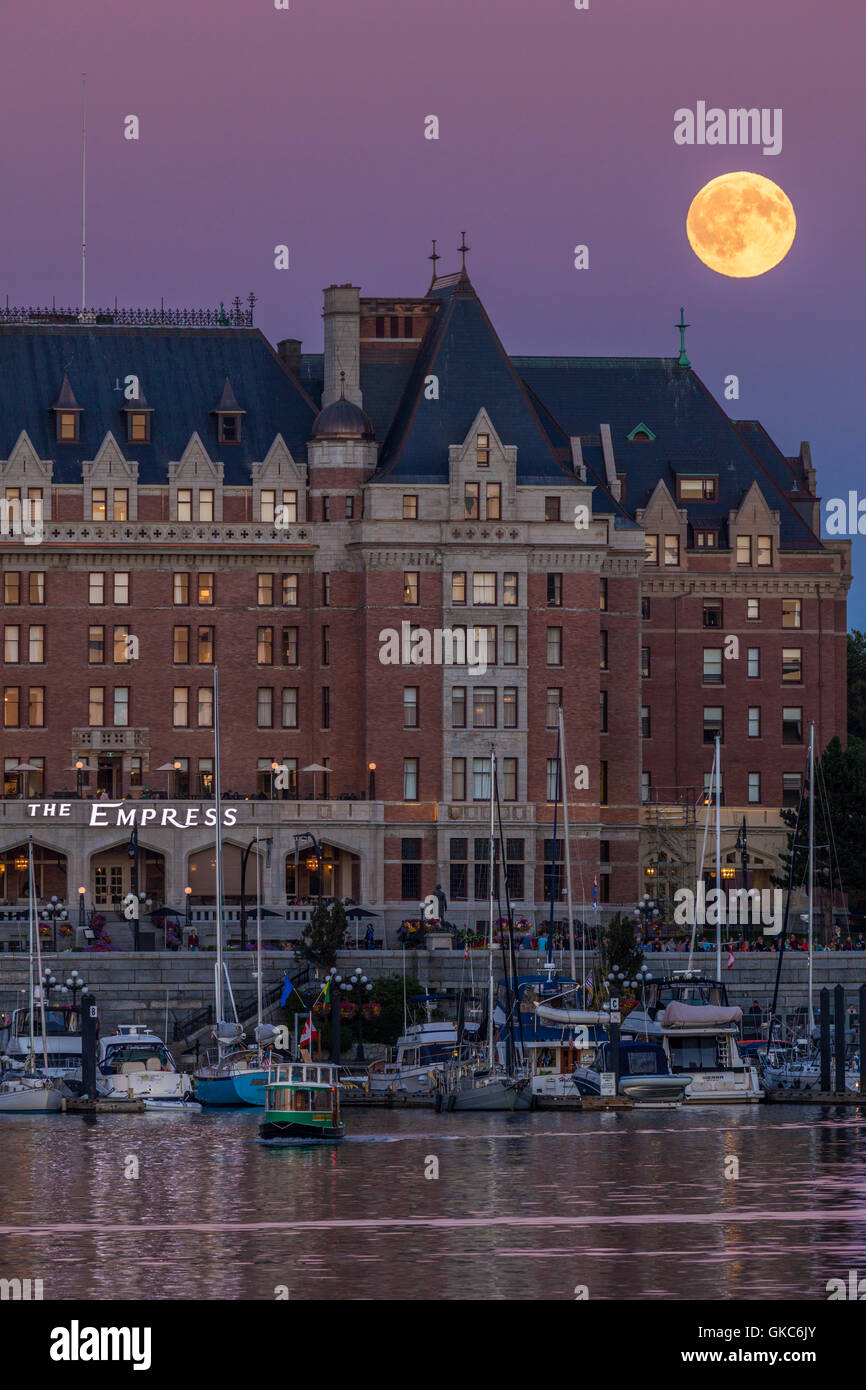 Empress hotel and Inner harbor with full moon rising-Victoria, British Columbia, Canada. - Stock Image