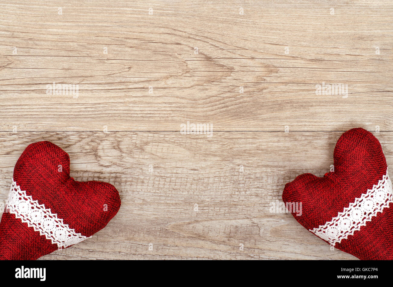 wooden board with two red hearts - Stock Image