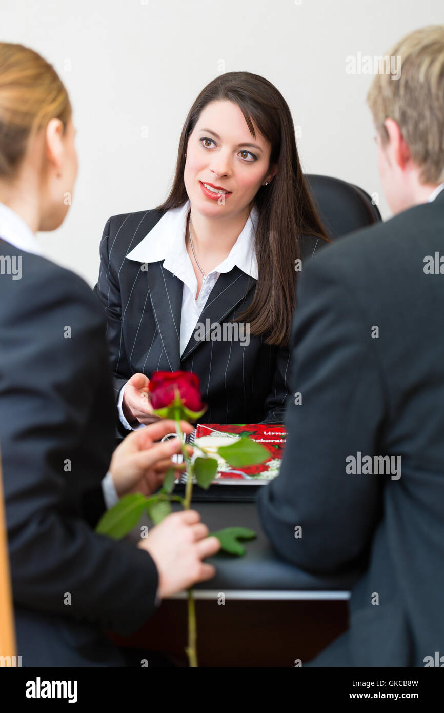 undertaker with customers - Stock Image