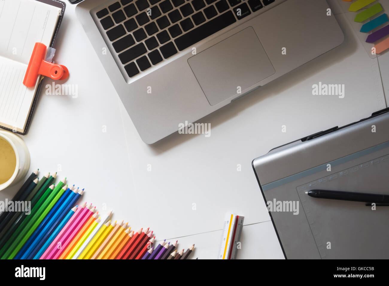 Graphic Design or Designer Creative Graphic Desk Table Dark Tone. - Stock Image