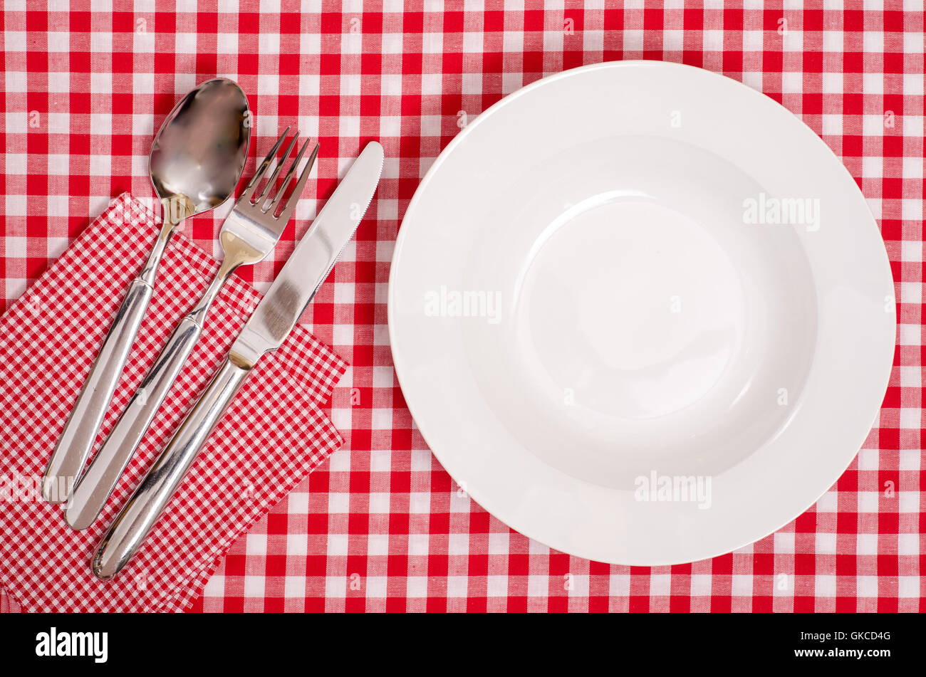 white plates and cutlery - Stock Image