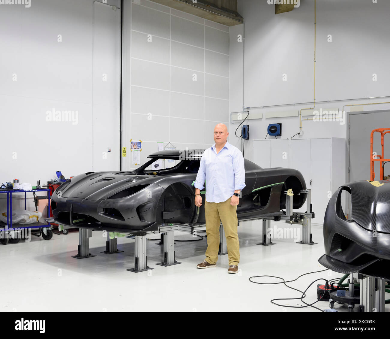 Christian von Koenigsegg standing in front of the shell of what will become one of the fastest cars in the world. Stock Photo