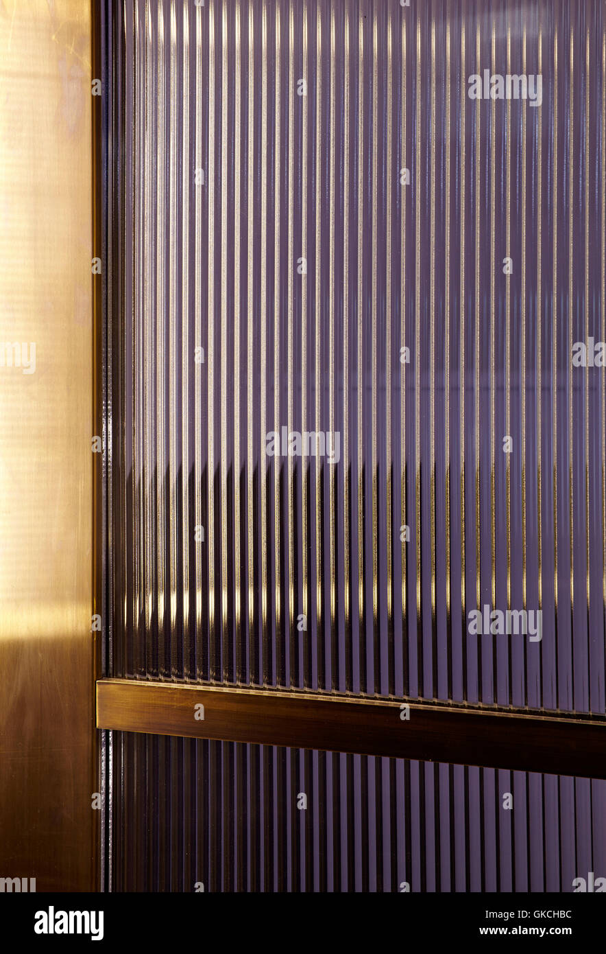 Detail of bevelled 20th Century class and bronze entrance door. 54 Brooks Mews, London, United Kingdom. Architect: - Stock Image