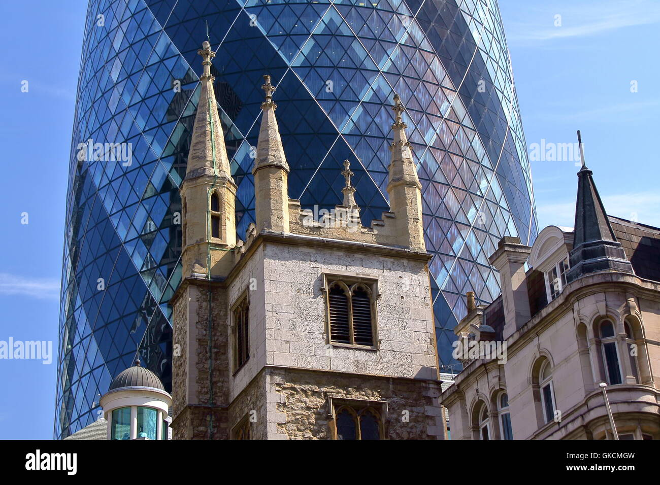 The Gherkin (30 St Mary Axe) with turrets in the foreground