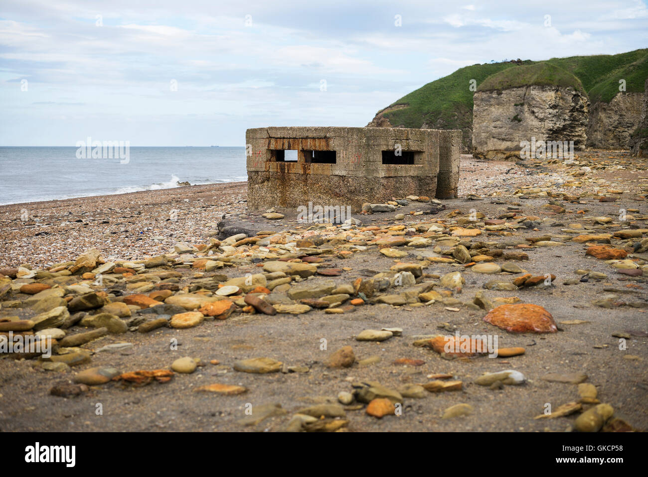 Ruined remains of a World War II concrete pillbox on Blast Beach, Nose's Point, Dawdon, Seaham, County Durham, - Stock Image