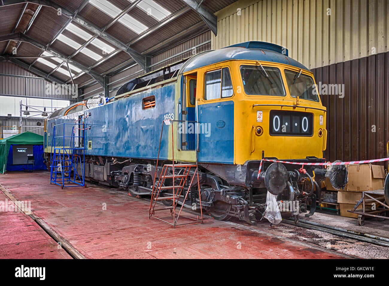 Class 47 47105 under restoration by the Type 4 Fund inside the diesel shed at Toddington Stock Photo