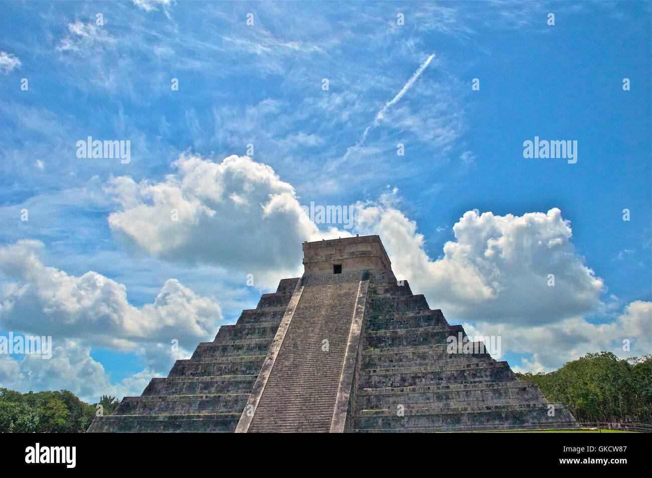 Dramatic Angled Front Facade of Chichen Itza with Clear Blue Sky, Tinúm Municipality, Yucatán State, Mexico. - Stock Image