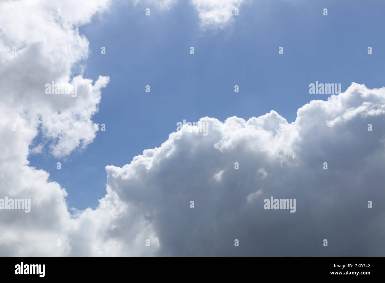 rainy cloud and blue sky background - Stock Image