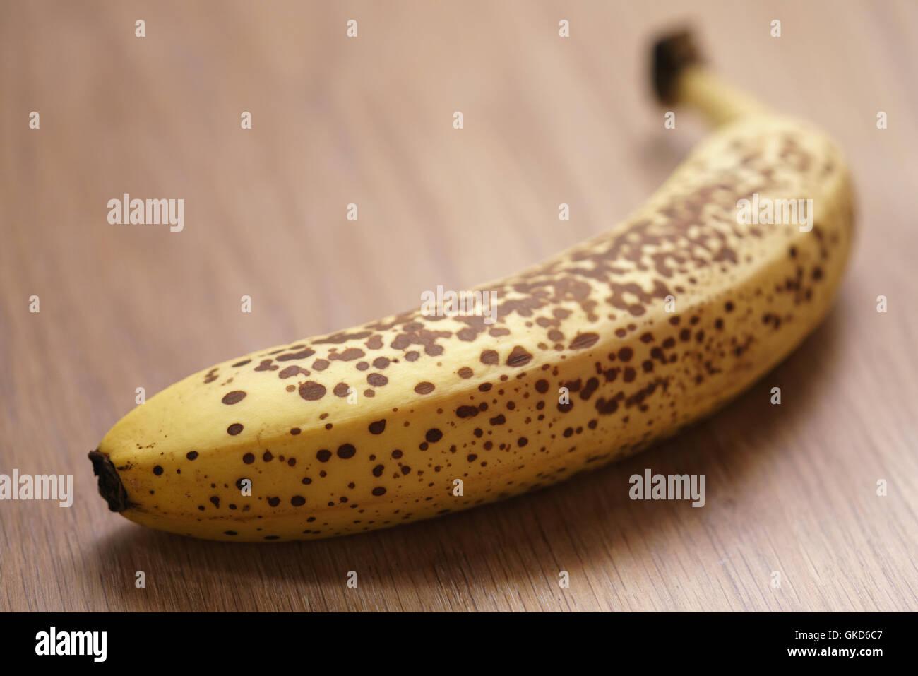 Banana On Table one banana with dots on wood table