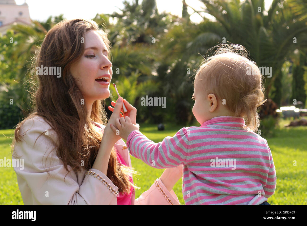 Clouse-up portrait. Mother and her little daughter making up. horizontal - Stock Image