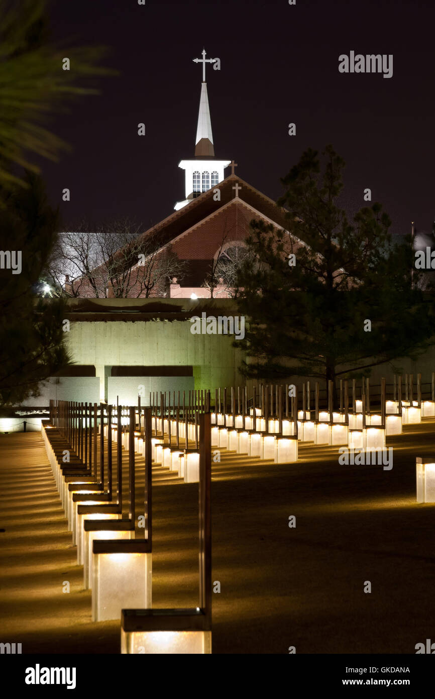 The Oklahoma City Bombing Memorial at night with 1st Methodist Church in the back. The church was badly damaged Stock Photo