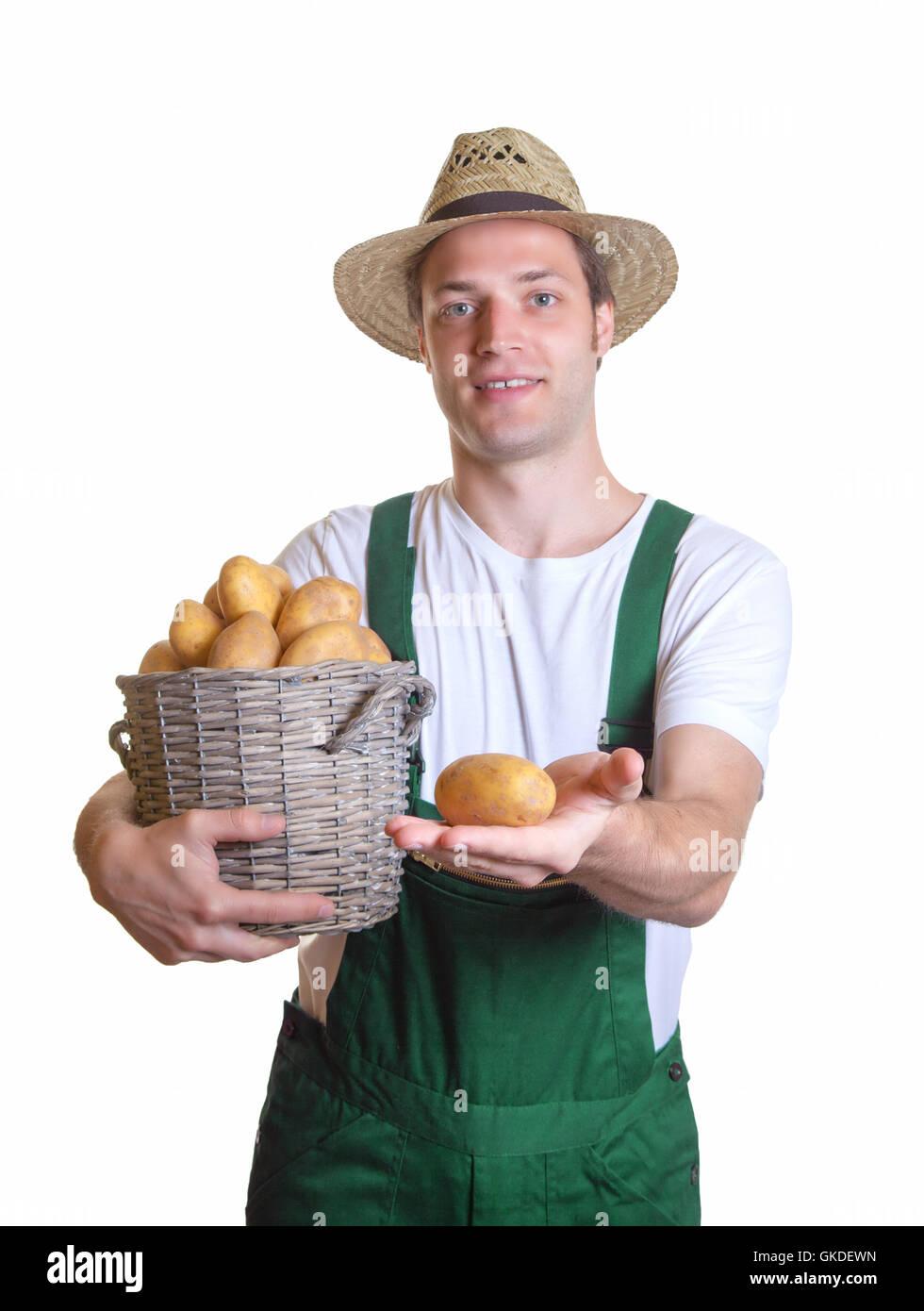 friendly gardener showing his potato Stock Photo