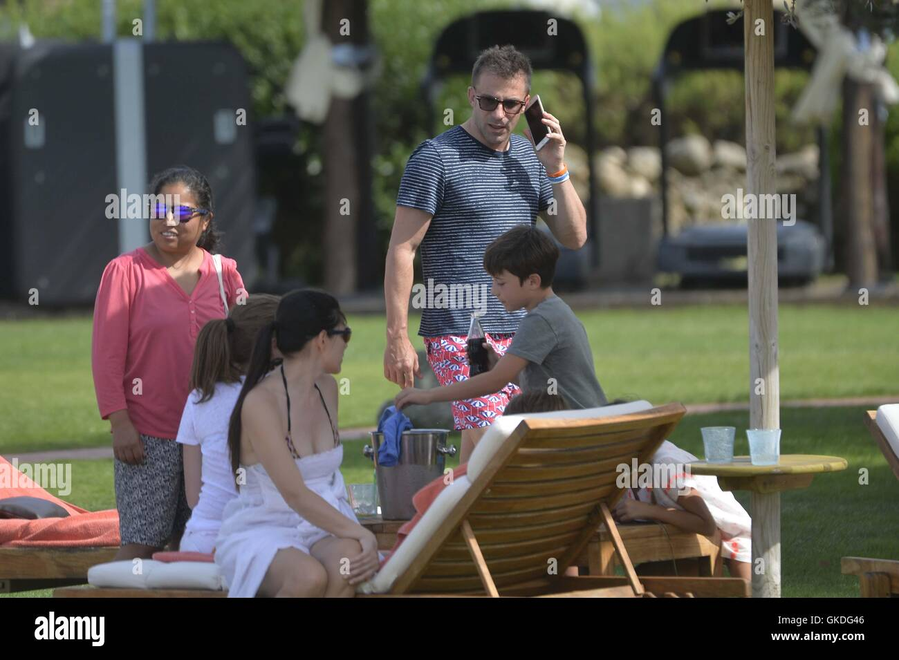Italian former professional footballer Alessandro Del Piero spends the day on the beach with his family in Porto - Stock Image