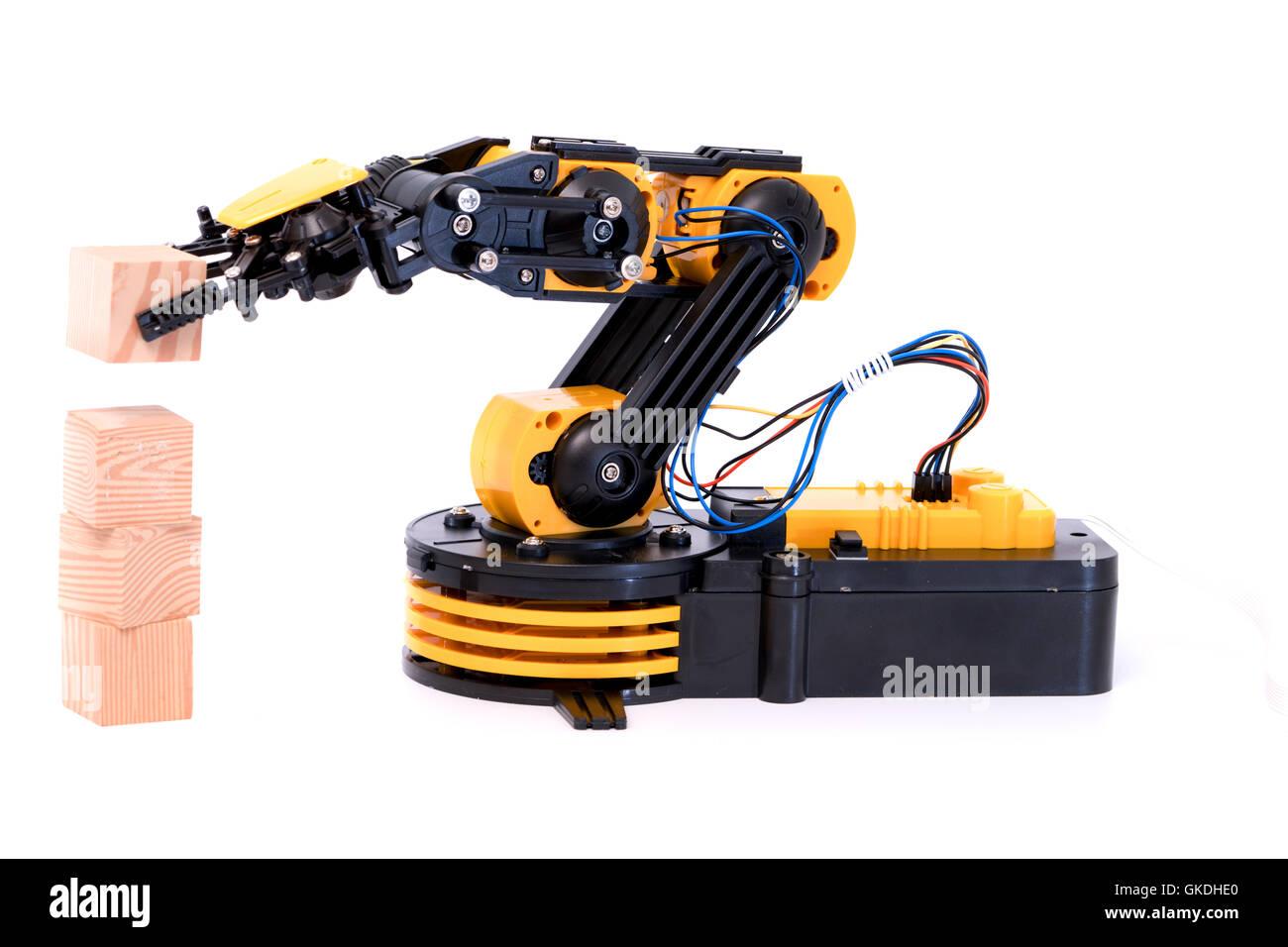 Plastic model of industrial robot arm - Stock Image