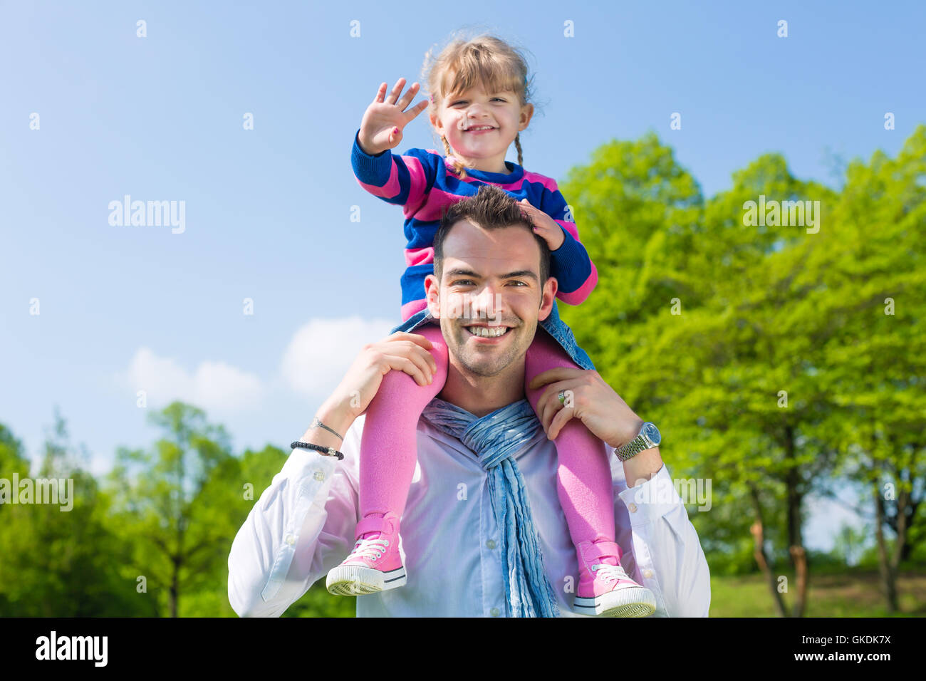 father and daughter in a summer meadow - Stock Image