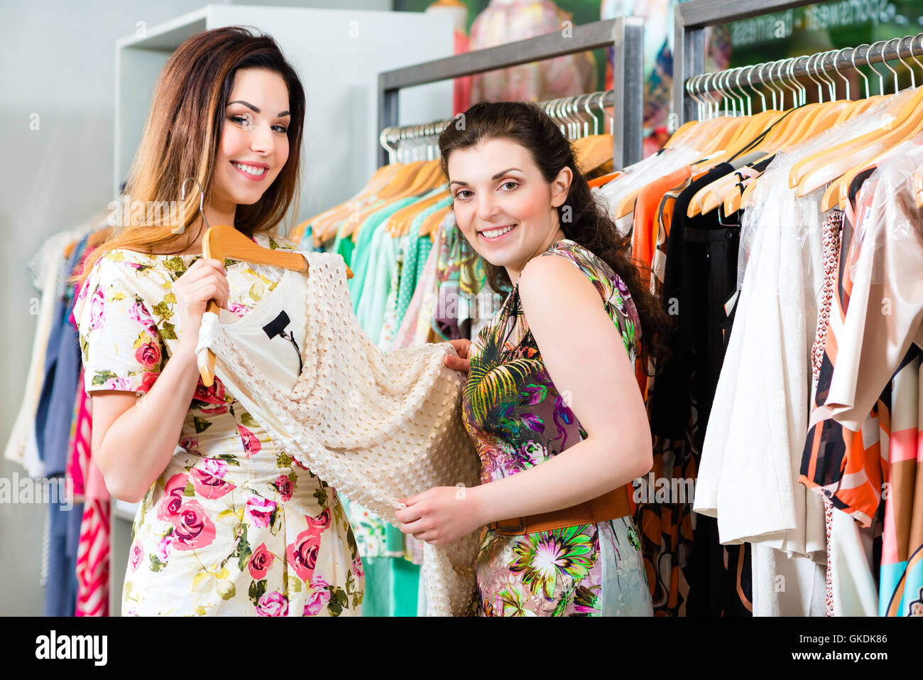 young women shopping in store or boutique Stock Photo
