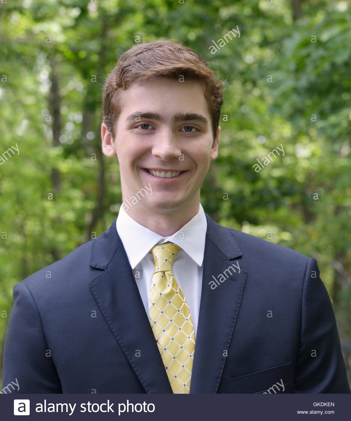 Handsome young man portrait, 19/20/21 years old, millennial generation or Gen Y, in suit and tie, outdoors - Stock Image