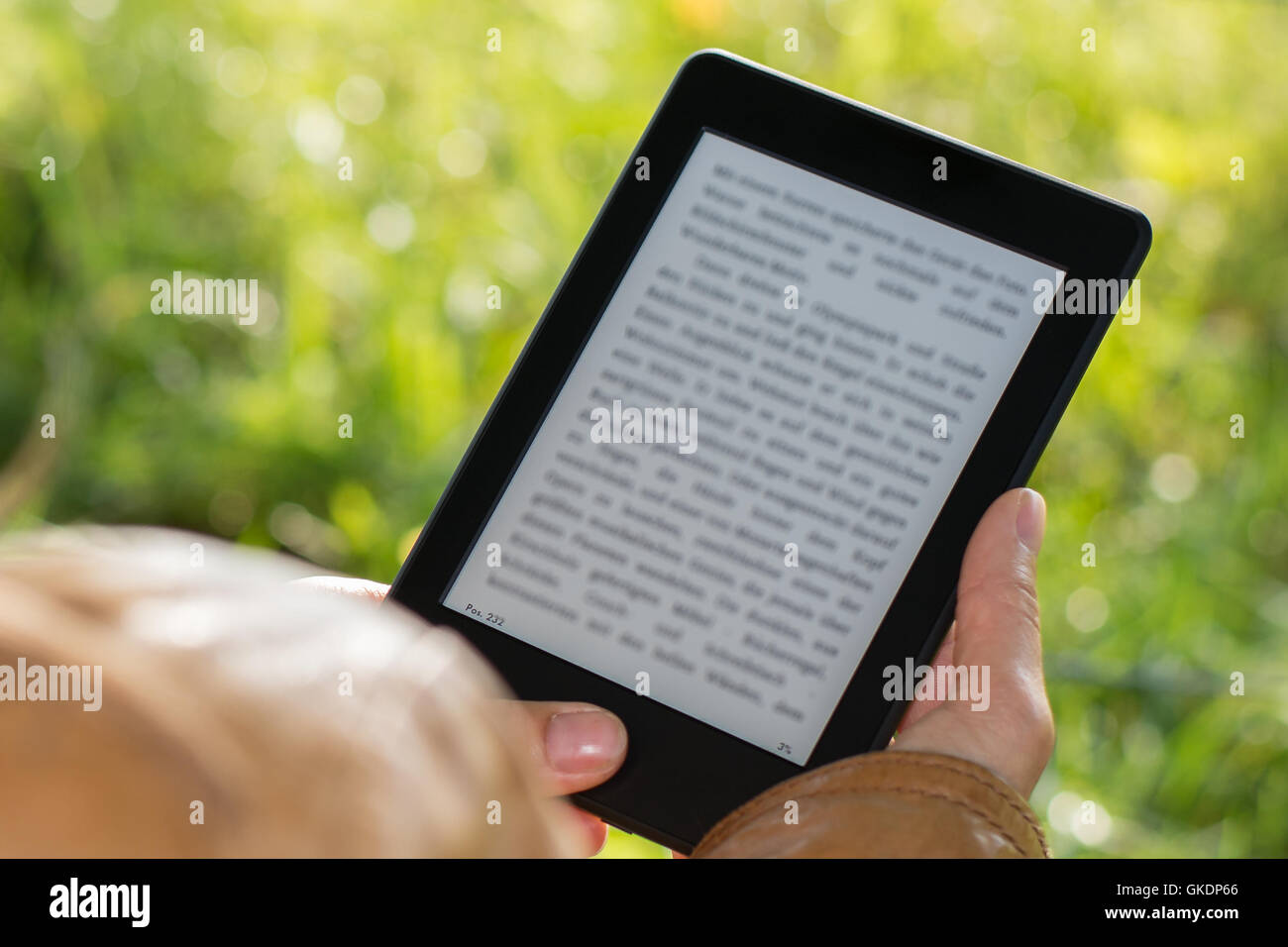 ebook reader outdoors in park - Stock Image