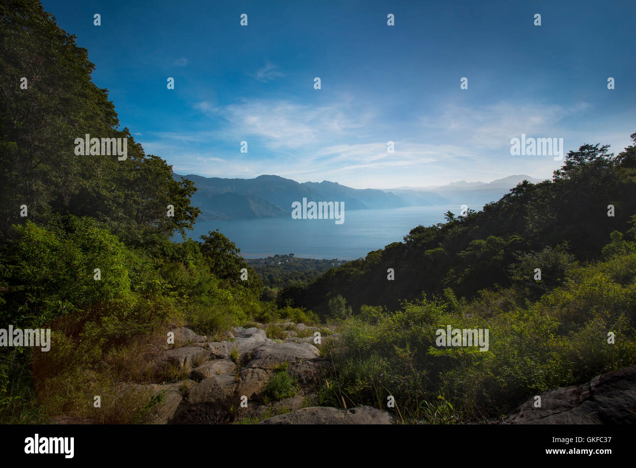 A view of Lake Atitlan and the surrounding mountains from the San Pedro Volcano in Guatemala - Stock Image