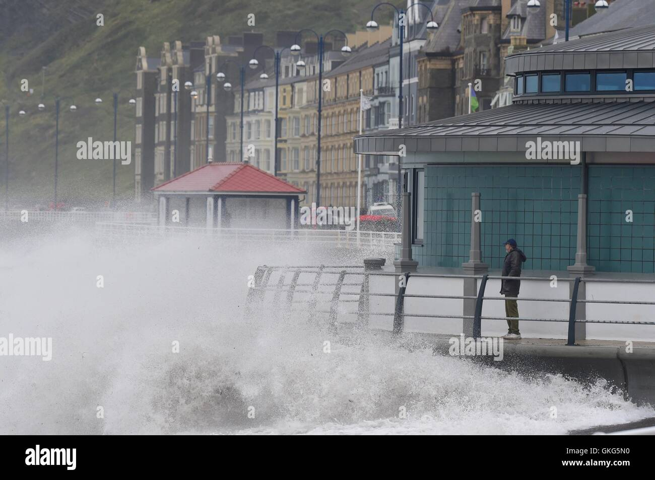 Aberystwyth Wales UK, Saturday 20 August 2016   At gale force winds and high tide bring huge waves crashing against Stock Photo