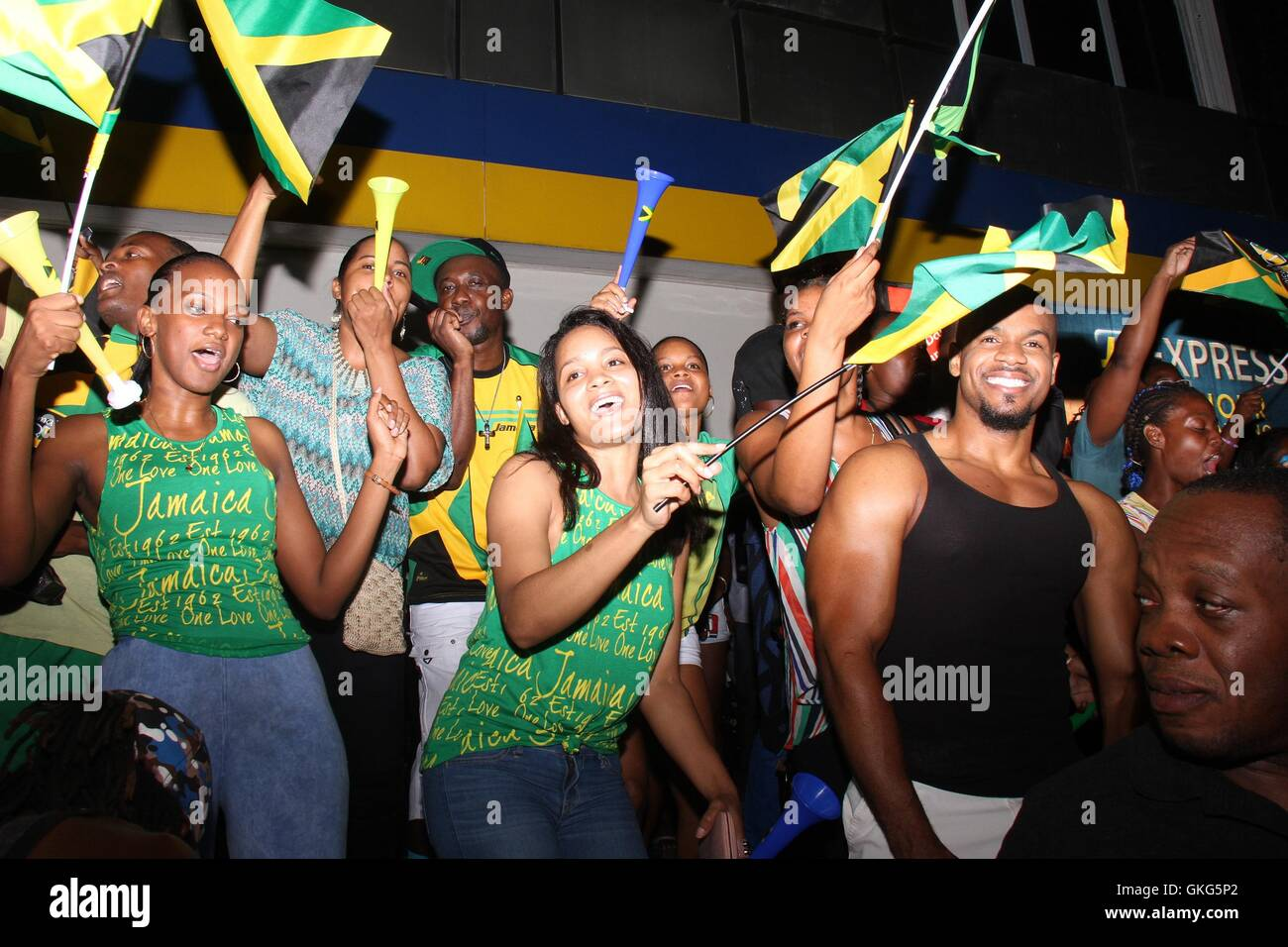 Kingston, Jamaica. 19th Aug, 2016. People celebrate Jamaican athletes winning the Olympic gold medal of the men's - Stock Image