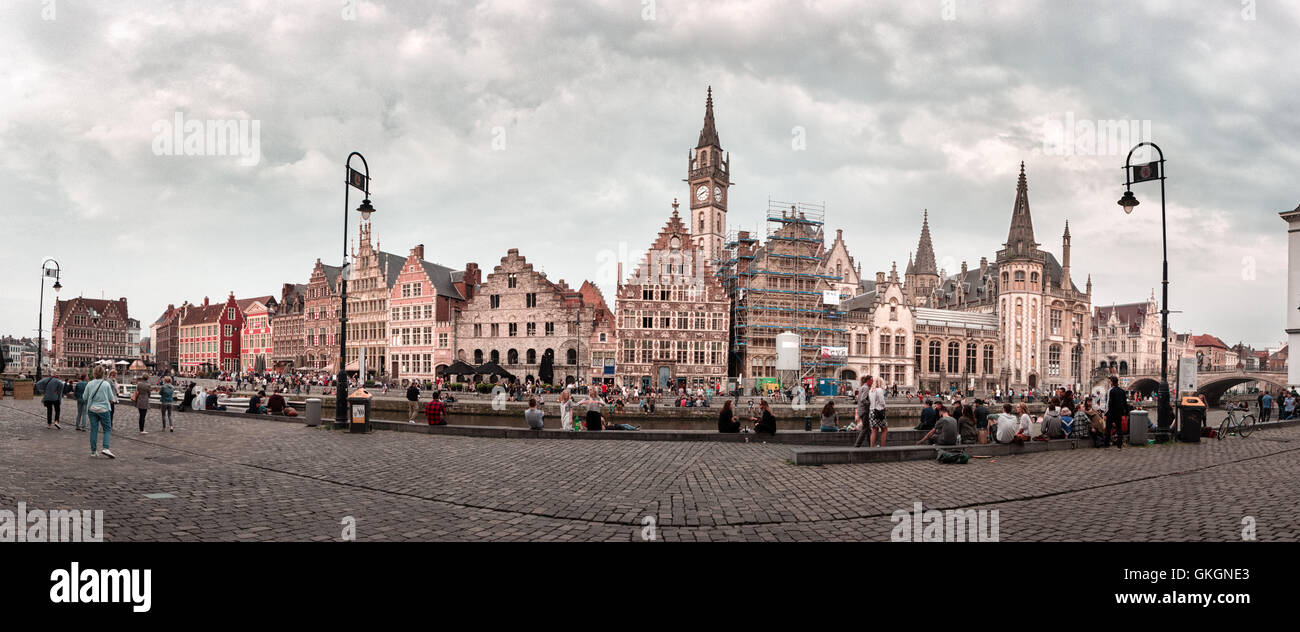GHENT, BELGIUM - MAY 27, 2016: An evening panorama of the old city of Ghent with medieval buildings and people on - Stock Image