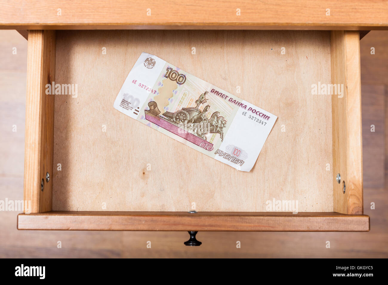 Top View Of One Hundred Russian Rubles Banknote In Open Drawer Of  Nightstand   Stock Image