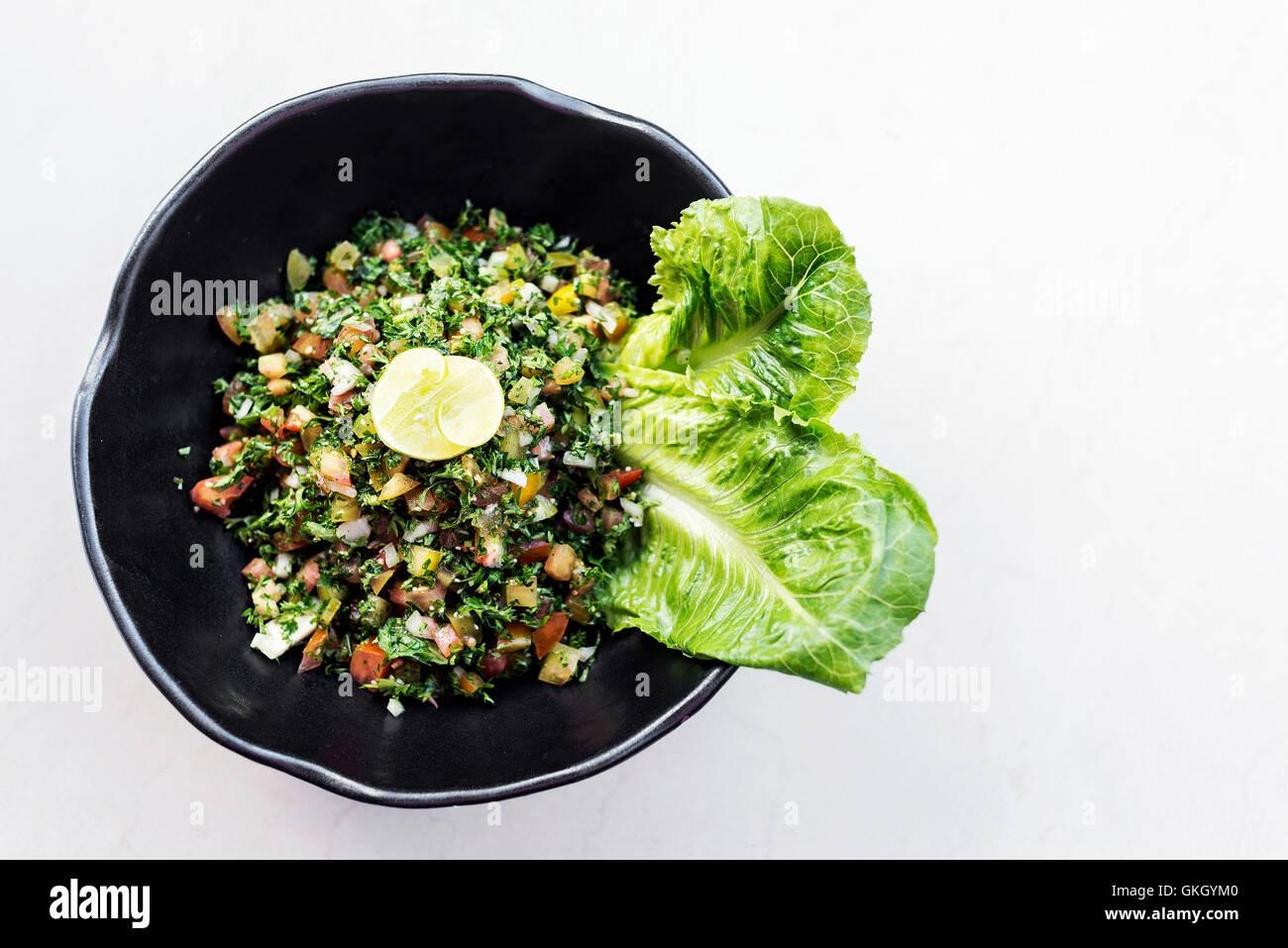tabouleh traditional lebanese middle eastern fresh salad bowl meze mezze starter - Stock Image