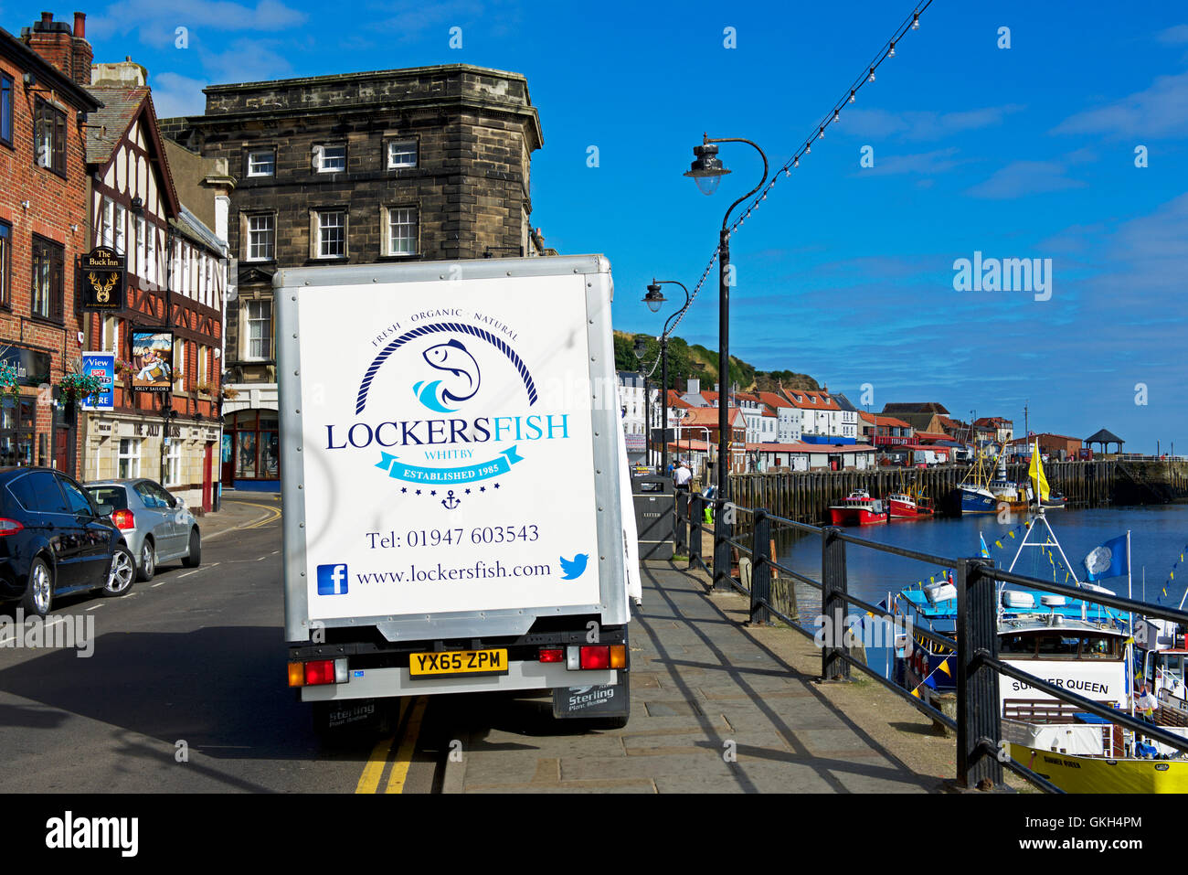 Wet fish delivery van parked on the quayside, Whitby, North Yorkshire, England UK - Stock Image