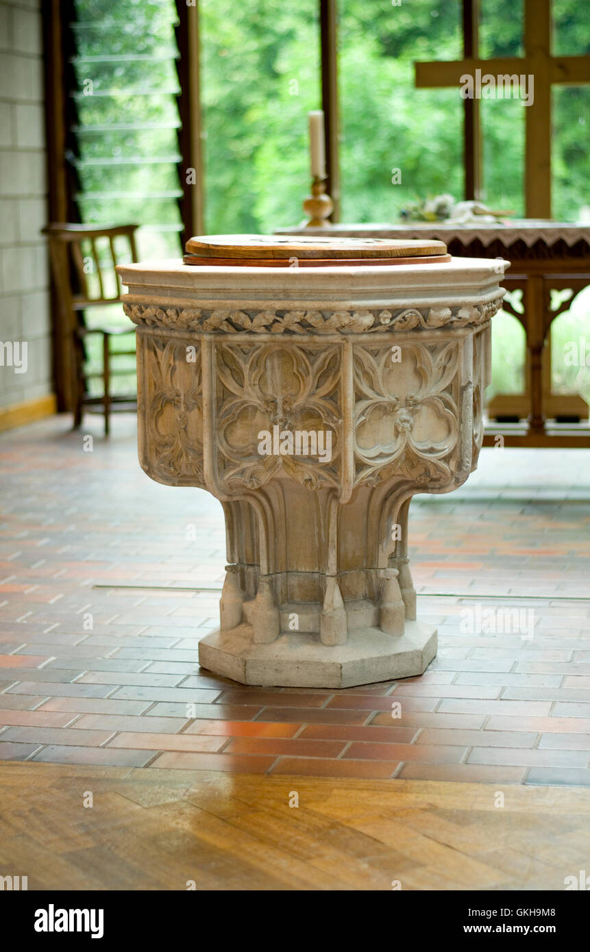 Stone font in a modern church. - Stock Image