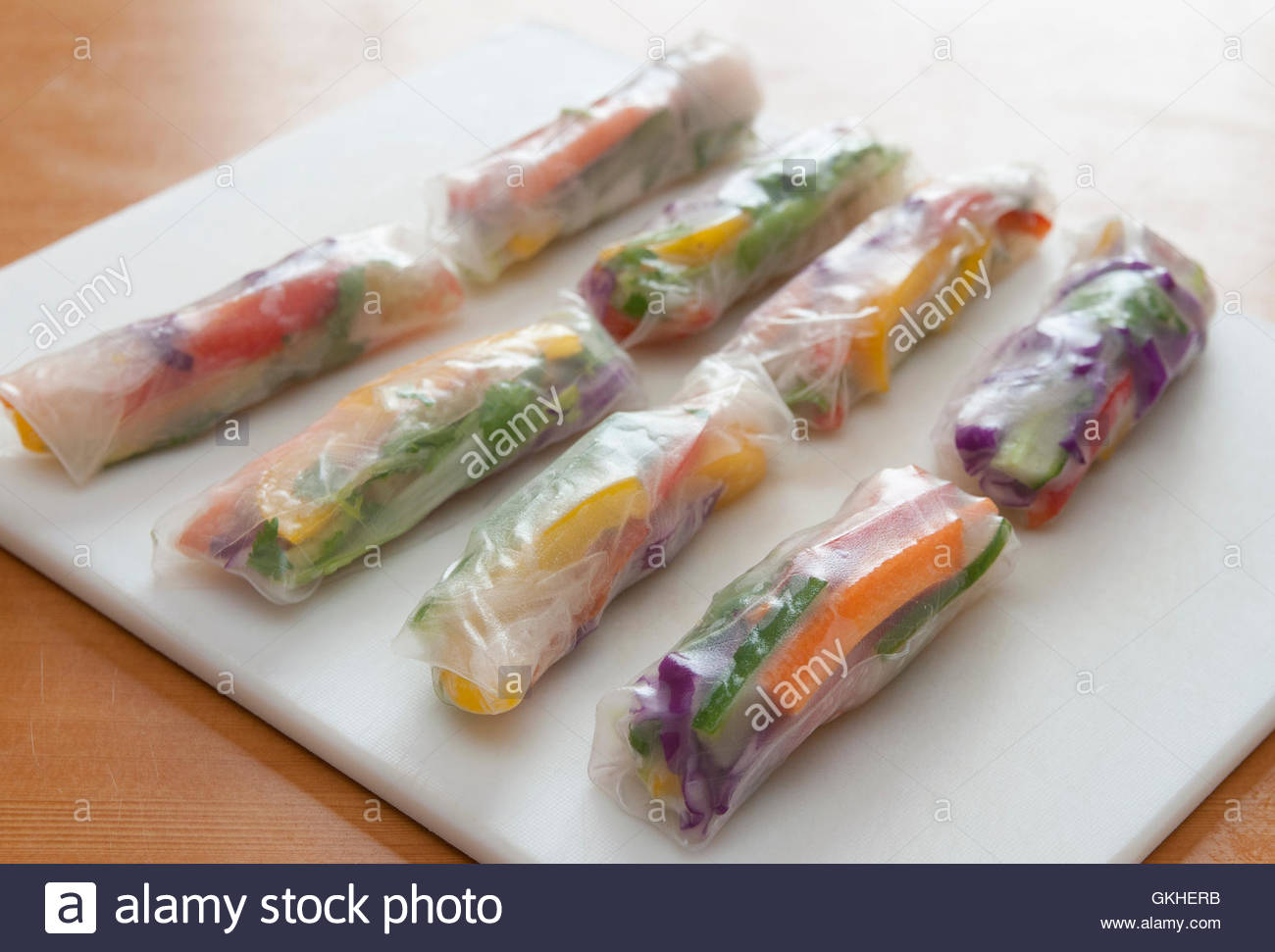 Rainbow vegetable spring rolls - Stock Image