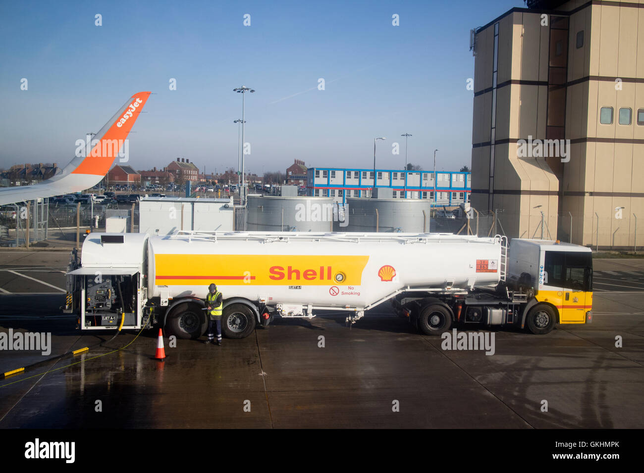 Shell oil jet-a1 refuelling tanker refuelling easyjet aircraft at liverpool john lennon airport in the uk - Stock Image