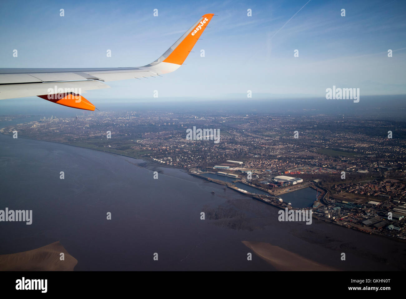 aerial view of easyjet aircraft flying over garston and speke Liverpool and the river Mersey - Stock Image